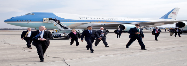 President Barack Obama arrives at Port Columbus International Airport. Columbus, Ohio with Senator Sherrod Brown, Rep. Mary Jo Kilroy, and Secret Service 3/6/09.  Official White House Photo by Pete Souza